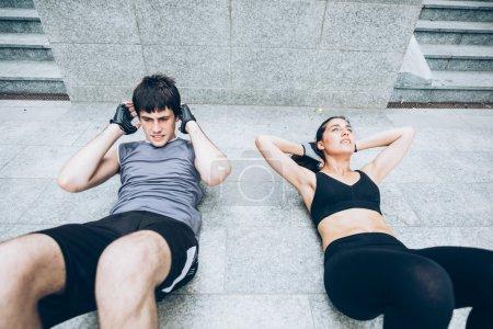 sportive Couple doing abdominal