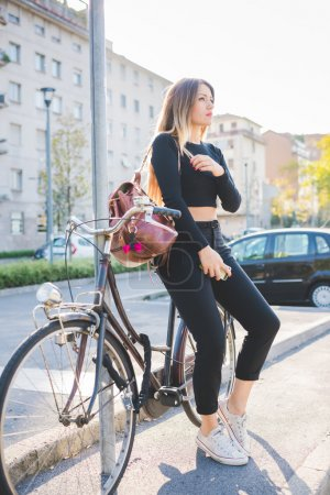 woman leaning on her bike