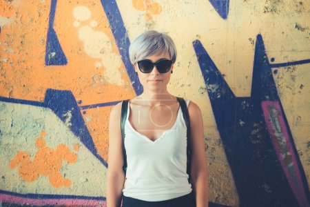 Photo for Young beautiful short blue hair hipster woman in the city - Royalty Free Image