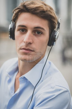 young model hansome blonde man with headphones