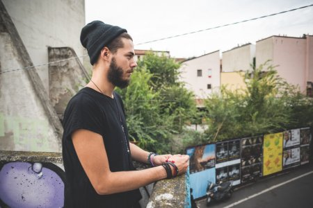 Bearded hipster man looking away