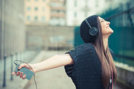 Photo for Crazy beautiful brunette woman listening music outdoors - Royalty Free Image