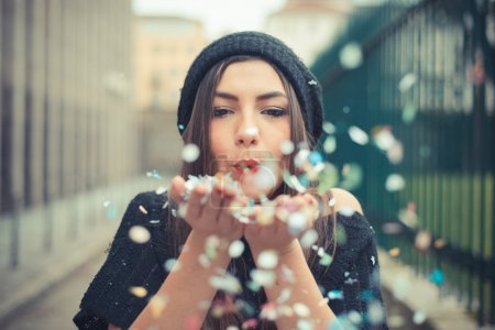 Photo for Young beautiful brunette woman girl outdoor with confetti - Royalty Free Image