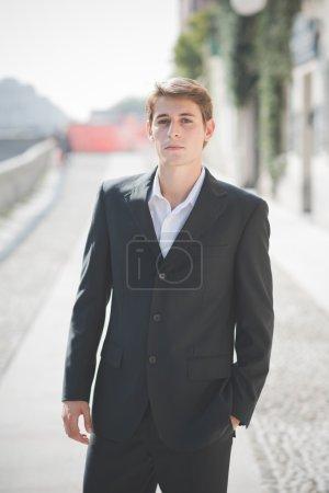 Blonde man posing on the street