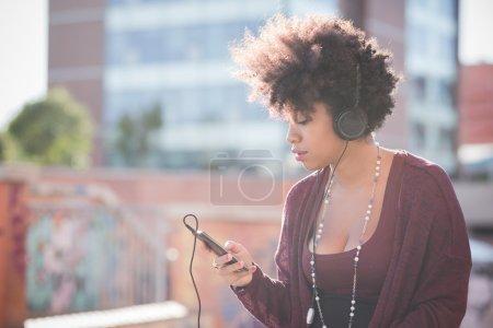 Beautiful woman listening music in headphones