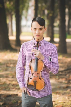 Young crazy musician violinist outdoors
