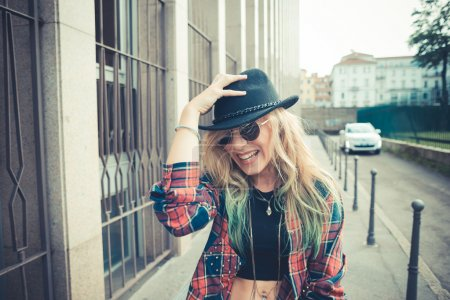 Photo for Beautiful young blonde hair woman hipster in the city - Royalty Free Image
