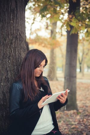 Young girl with tablet in park