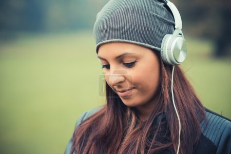 young girl in park listening music