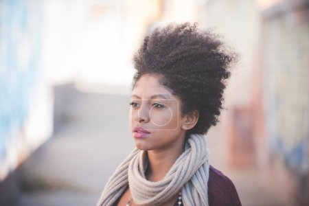 Photo for Beautiful black curly hair african woman in town - Royalty Free Image