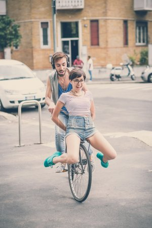 Young man and woman riding bike