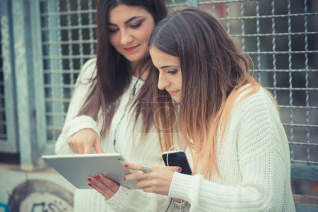 two girls  using tablet