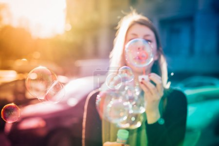 hipster girl blowing bubbles