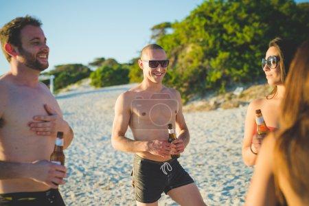 young friends on summer beach