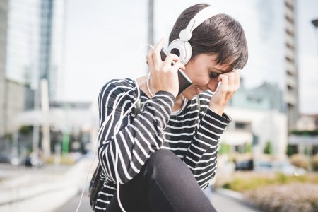 Young handsome woman listening music