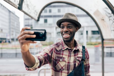 afro black man holding a smartphone
