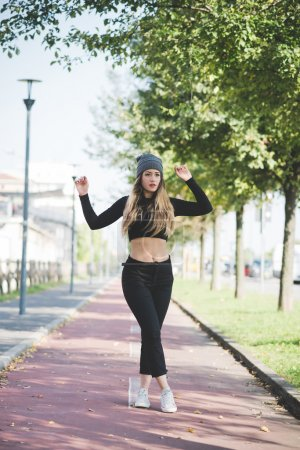 Woman model posing outdoor in city