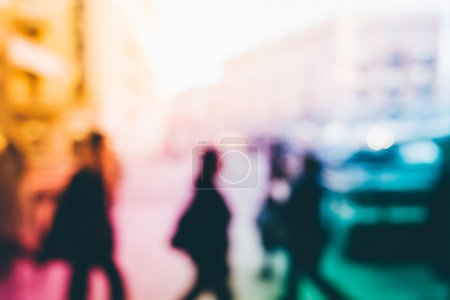 Blurred people walking outdoor
