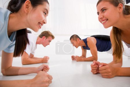 Young multi ethnic people exercising in gym