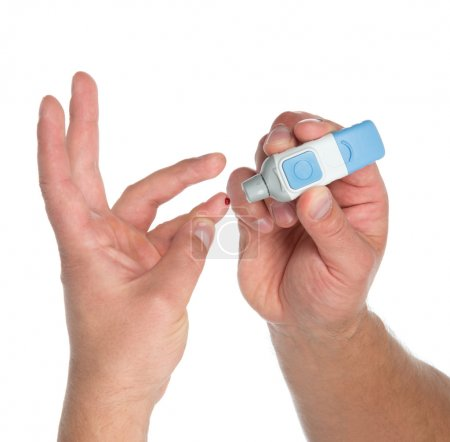 Diabetes lancet in hand prick finger to make punctures