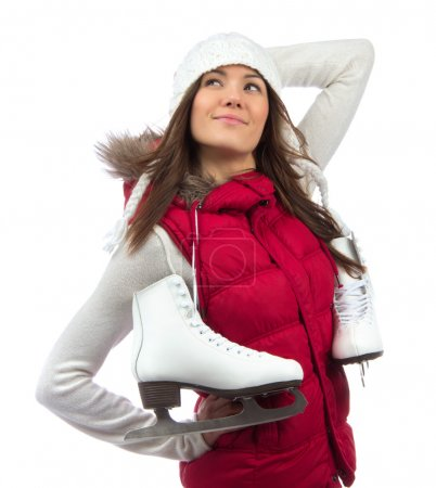 Photo pour Happy young girl with ice skates getting ready for ice skating winter sport activity in hat smiling isolated on a white background - image libre de droit