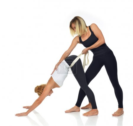 Doctor physiotherapist stretching a young sport woman