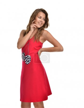 Young beautiful brunette woman posing in modern red dress isolat