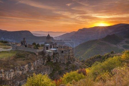The ancient monastery in the setting sun. Tatev. Armenia.