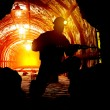 Silhouettes of worker in the mine....
