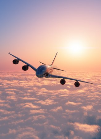 Photo for Passenger plane above the clouds. - Royalty Free Image