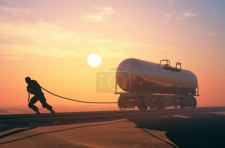 Photo for Man pulls a rope rail car. - Royalty Free Image
