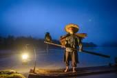 Čínská Cormornat rybář