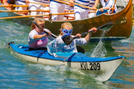 Oarsmen in the Venice Vogalonga regatta, Italy.