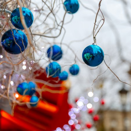 Blue shiny balls on Christmas street in Paris, France