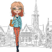 Beautiful fashion girl top model in glasses with bag on a medieval city Bruges street