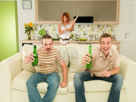 ecsited men watching tv