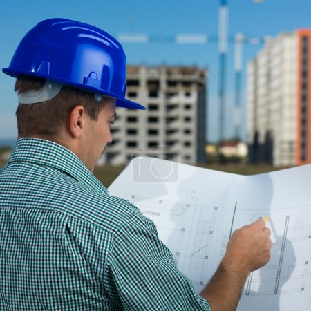 engineer reading construction plan