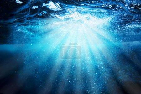 Sea bottom with blue water wave splash background