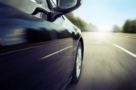 Blurred road and car
