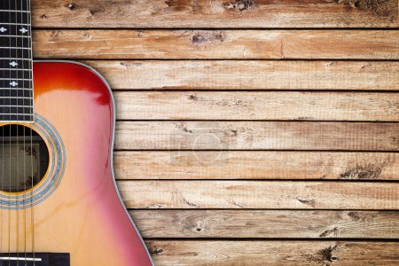 Guitar against wood background