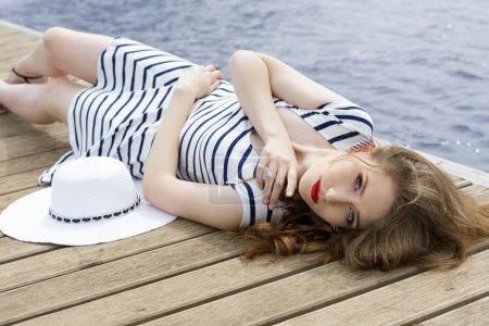fashion woman on wood jetty
