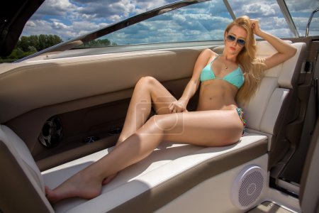 Blonde woman on her private yacht