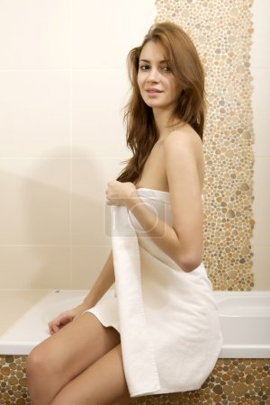 Photo for Portrait of beautiful young adult sensuality sexy and attractive pretty brunette woman in home bathroom with white towel on her body - Royalty Free Image
