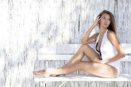 beautiful brunette woman on the beach