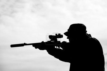 Hunter with rifle gun...