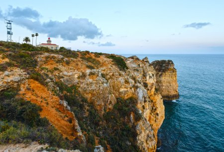 Evening view of lighthouse (Algarve, Portugal).