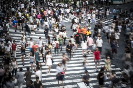 Photo for Motion blur on large crowd at the famous Shibuya Crossing in the Japanese capital - Royalty Free Image