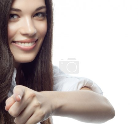 Photo for Closeup portrait of attractive  caucasian smiling woman brunette isolated on white studio shot lips toothy smile face hair head and shoulders looking at camera tooth habd finger pointing to businesswoman - Royalty Free Image