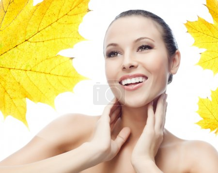 Photo for Portrait of attractive  caucasian smiling woman isolated on white studio shot autumn leave - Royalty Free Image