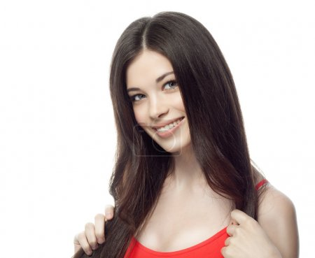 Photo for Closeup portrait of attractive  caucasian smiling woman brunette isolated on white studio shot lips toothy smile face hair head and shoulders looking at camera tooth - Royalty Free Image